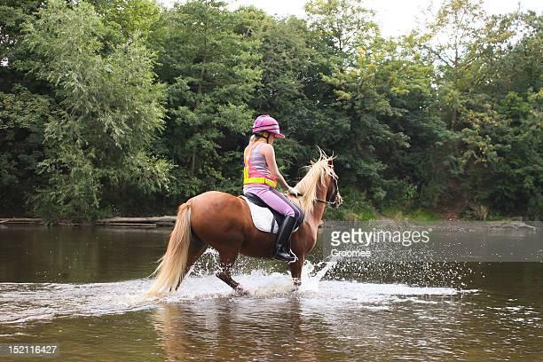 river riding-girl and her pony enjoying a summer splash - pony play bildbanksfoton och bilder