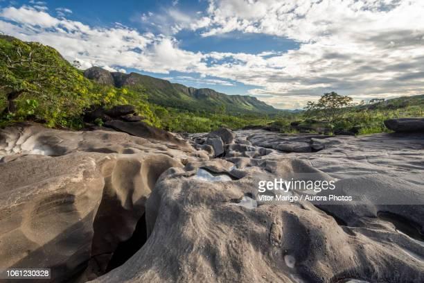 river running among rocks in vale da lua moon valley, chapada dos veadeiros, goias, brazil - cerrado stock pictures, royalty-free photos & images