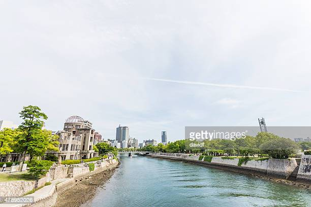 river running past the atomic bomb dome in hiroshima - hiroshima peace memorial stock photos and pictures