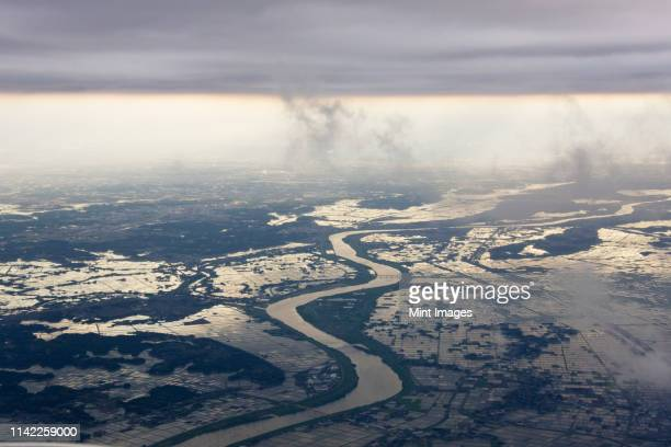 river running through a flooded countryside - 自然災害 ストックフォトと画像