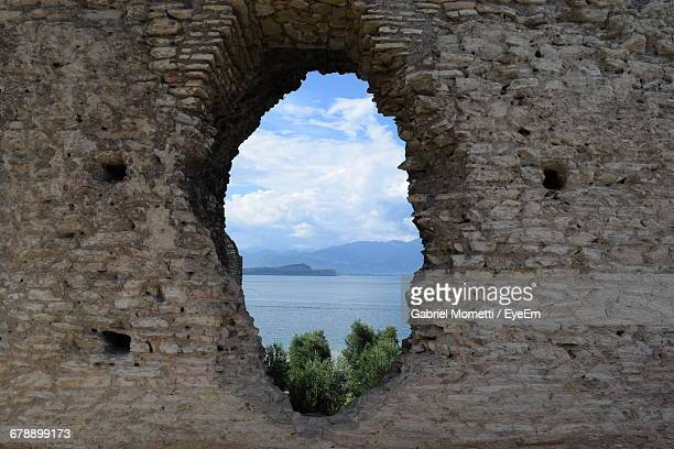River Seen Through Hole At Historic Building