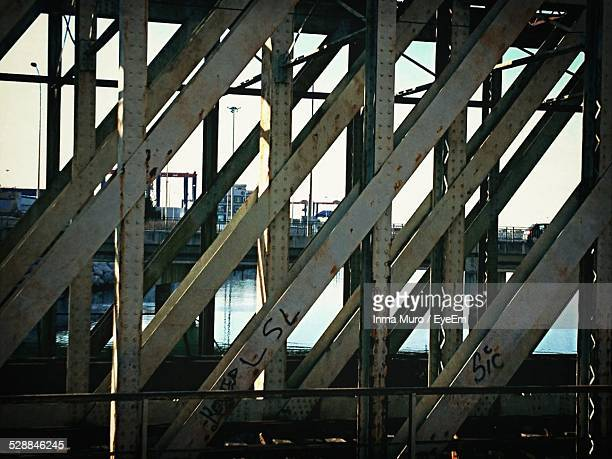 river seen through metal structure - muro stock photos and pictures