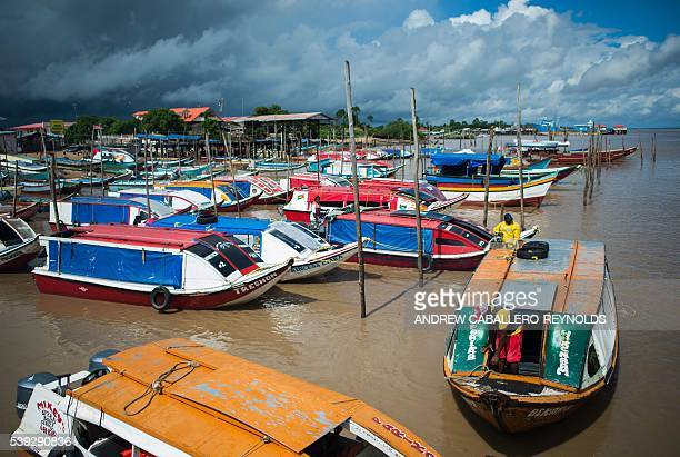 River taxis wait for customers at the dock in the town of Parika Guyana on June 6 2016 / AFP / Andrew CaballeroReynolds