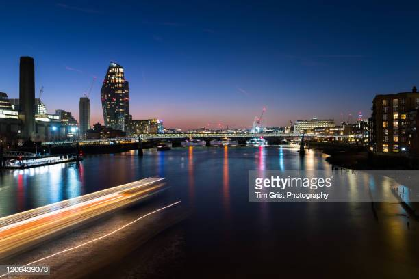 river thames and london skyline at sunset - tim grist stock pictures, royalty-free photos & images
