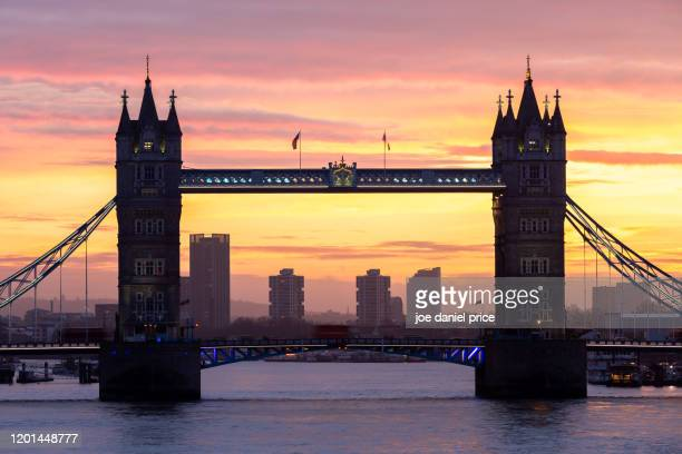 river thames, dramatic sunrise, tower bridge, london, england - built structure stock pictures, royalty-free photos & images