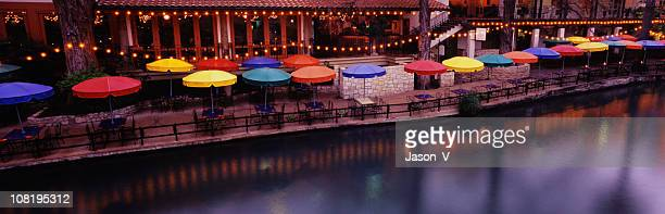 river walk in texas with patio tables - san antonio texas stock photos and pictures