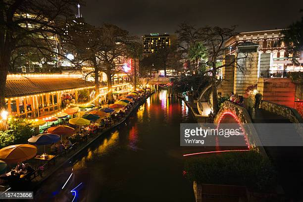 river walk, san antonio, texas, showing sidewalk cafe night life - san antonio stock photos and pictures