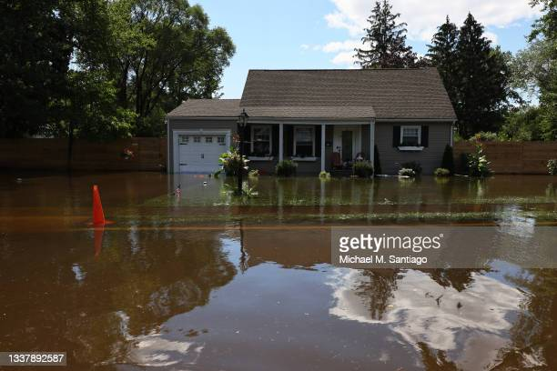 River water floods the front of a home on West Williams Street Road on September 02, 2021 in Lincoln Park, New Jersey. NJ Gov. Phil Murphy declared a...