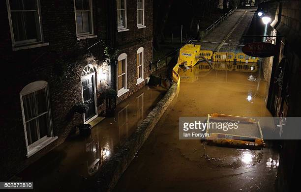 River water floods the road in front of a property on the banks of the river Ouse on December 27 2015 in York England Heavy rain over the Christmas...