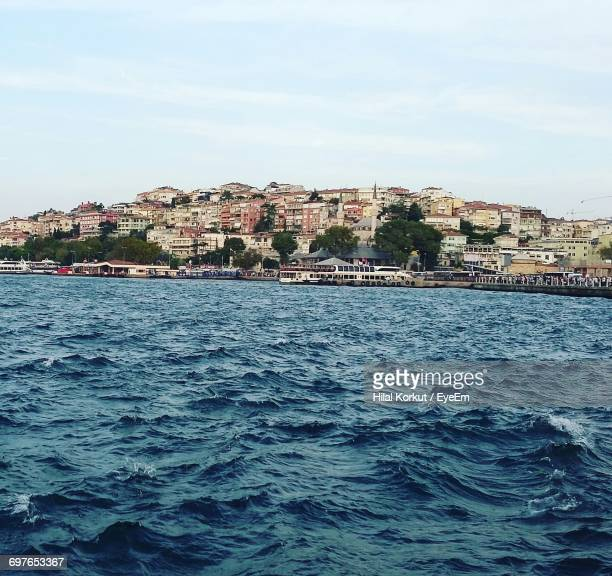 river with buildings in background - hilal stock photos and pictures