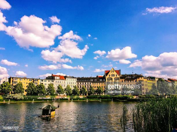 river with buildings in background - kreuzberg stock photos and pictures