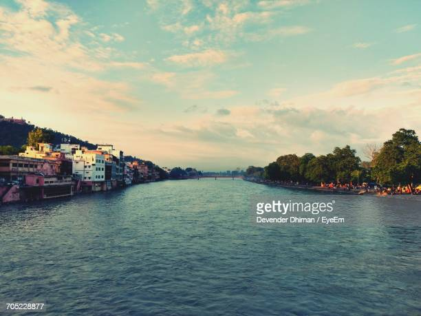 river with buildings in background - haridwar stock pictures, royalty-free photos & images