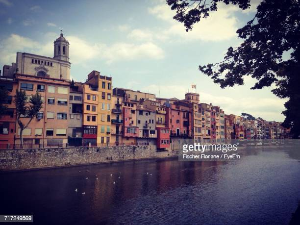 river with buildings in background - perpignan stock photos and pictures