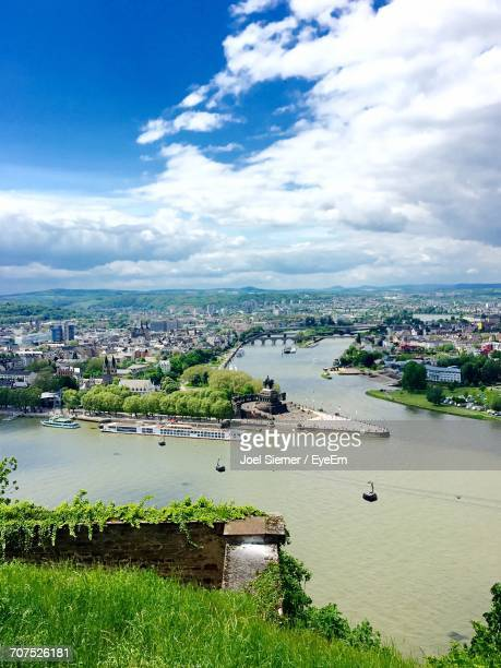 River With Cityscape In Background