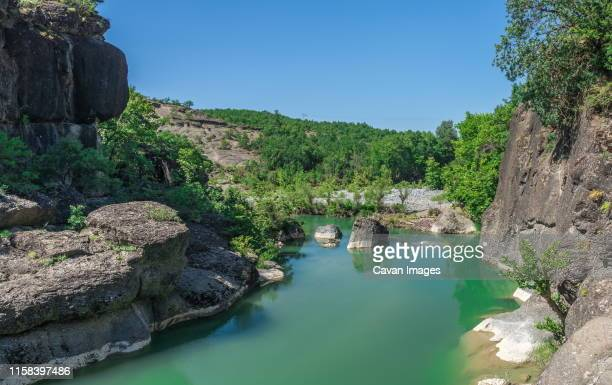 river with green water in greece - thessaly stock pictures, royalty-free photos & images