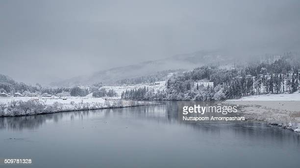 river with snow town - mishima city stock photos and pictures