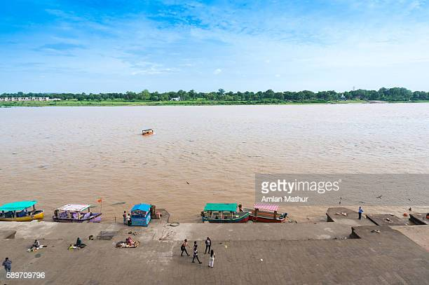 Riverbank showing the muddy waters of the narmada
