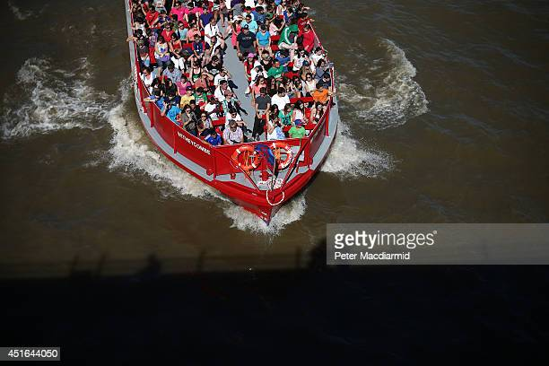 A riverboat carries tourists on the River Thames on July 3 2014 in London England Southern England has recorded the highest temperature of the year...