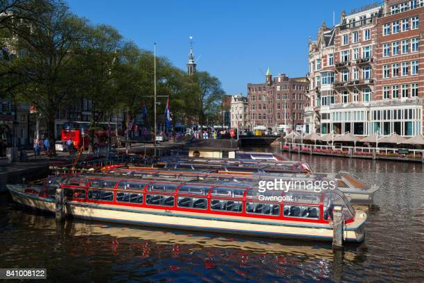 Riverboats in a canal in Amsterdam