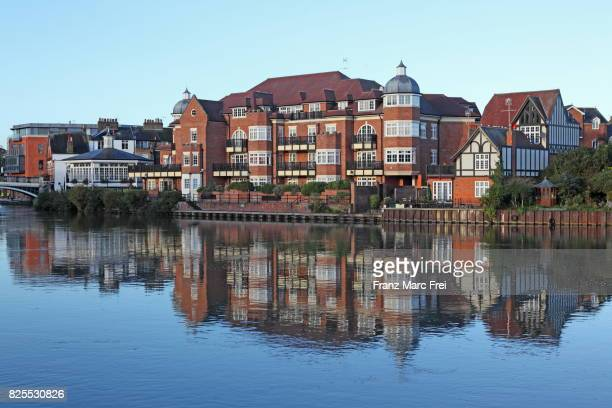 Riverfront of Eton reflects in river Thames, Berkshire, England