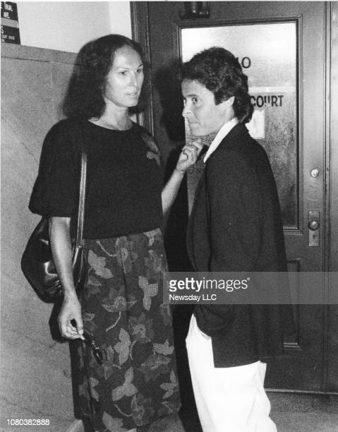 Dr Renee Richards and Mary Carillo wait outside the courtroom at the Supreme Court in Riverhead New York on September 25 1986 during Martina...