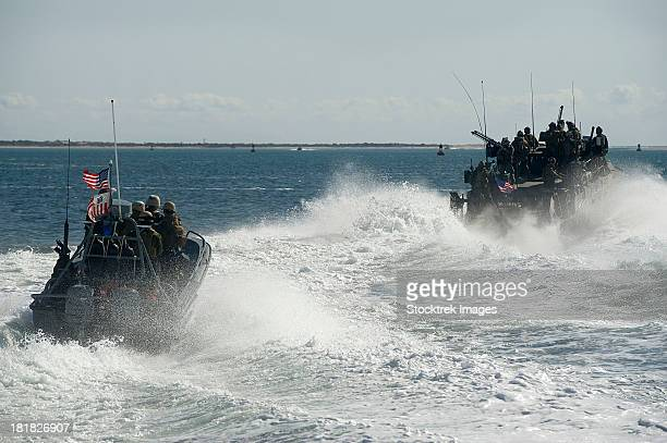 Riverine Command Boats and security boats practice maneuvers.