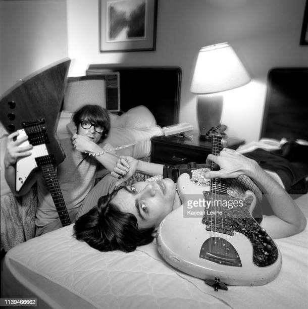 Rivers Cuomo and Brian Bell relax at their hotel before a Weezer show on August 26 1994 in New York City New York