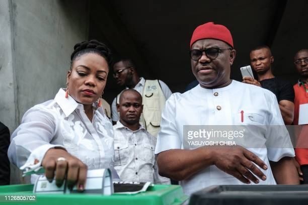 Rivers state's Governor Ezenwo Nyesom Wike and his wife and Eberechi Wike cast their ballot as voting in the presidential and parliamentary elections...