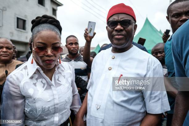 Rivers state's Governor Ezenwo Nyesom Wike and his wife Eberechi Wike leave after voting in the presidential and parliamentary elections on February...