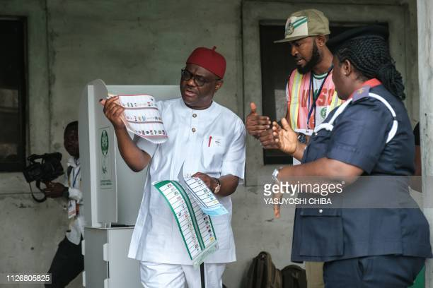 Rivers state's Governor Ezenwo Nyesom Wike walks to cast his vote in the presidential and parliamentary elections on February 23 at a polling station...