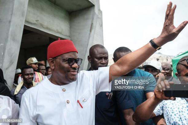 Rivers state's Governor Ezenwo Nyesom Wike waves as he leaves a polling station after voting in the presidential and parliamentary elections on...