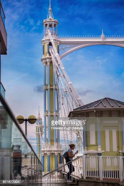 riverside approach to the historic albert bridge - battersea park stock pictures, royalty-free photos & images