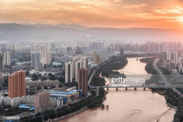 riverside city at orange dusk, lanzhou, gansu, china - gansu province stock pictures, royalty-free photos & images