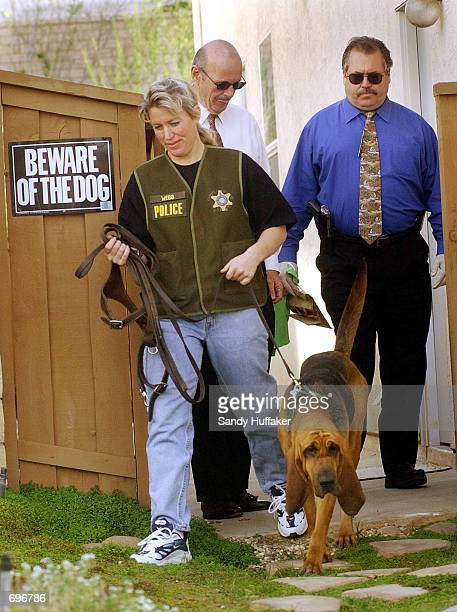 Riverside County Police investigators leave after searching Brenda and Damon van Dams neighbors property with a sniffer dog for any new clues on...