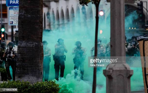 Riverside County Sheriffs fire tear gas towards protesters after they moved a fence into the street during the coronavirus pandemic on June 1 2020 in...