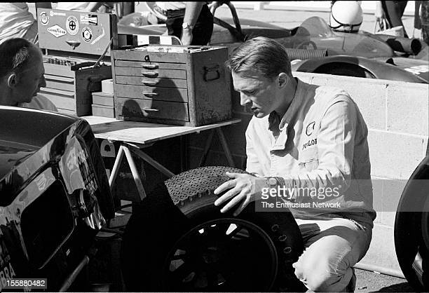 Riverside Grand Prix Dan Gurney looks over the Goodyear tires in the pits