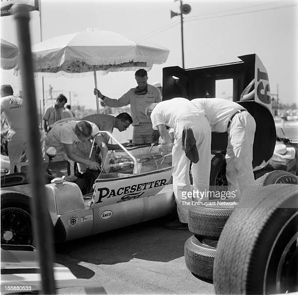 Riverside Grand Prix The Pacesetter Homes crew work on Dan Gurneys Lotus 19B as he looks on in back