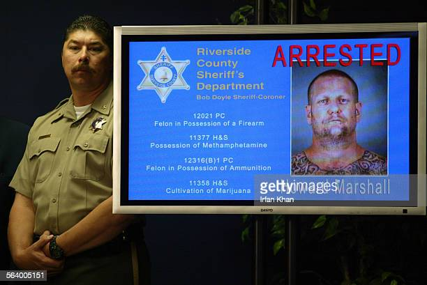 Riverside Jan25 2005 – – Chief Deputy Mike Andrews left stands by a mug of Andrew MarshallThe investigation that has resulted in the arrests of 19...
