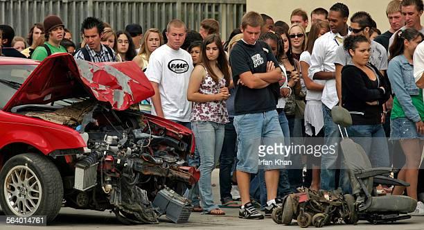 Riverside June 06 2007 – – – – Martin Luther King Jr High School students file past crash–damaged 2001 Volkswagen Jetta and remains of a mangled...