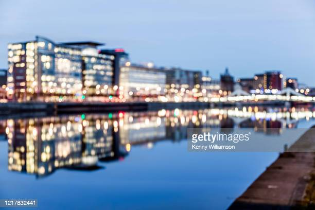 riverside offices in a city at dusk - glasgow scotland stock pictures, royalty-free photos & images