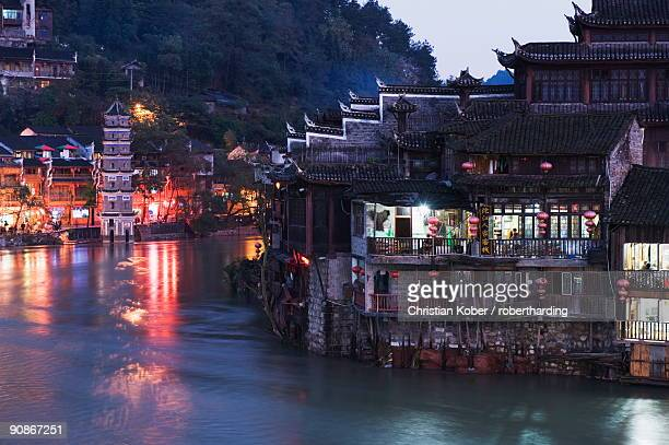 Riverside, old town illuminated at night, Fenghuang, Hunan Province, China, Asia