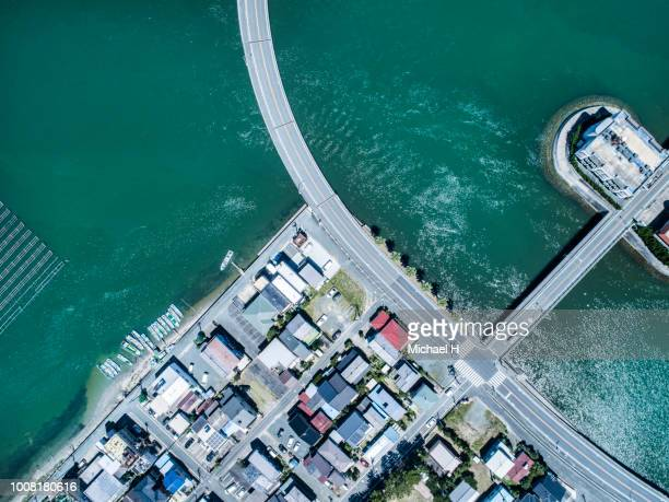 riverside residential area  with lining up fishing boats - 沿岸 ストックフォトと画像