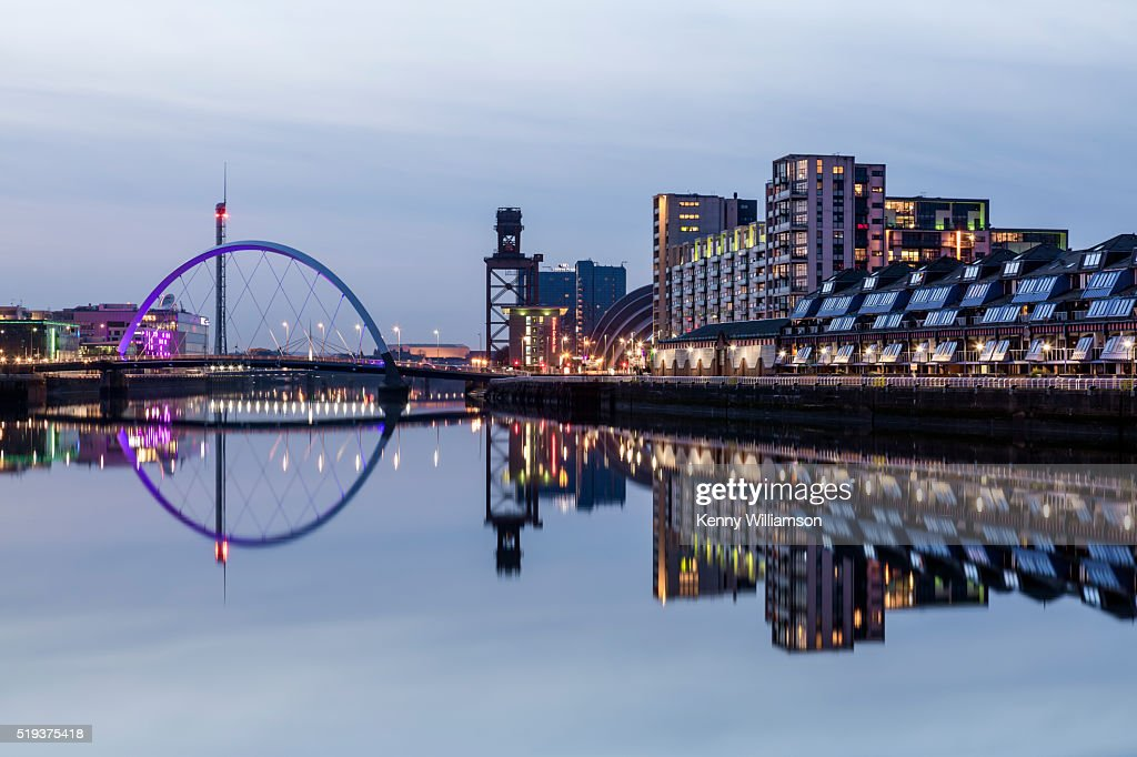 A riverside view of a city at night : Stock Photo