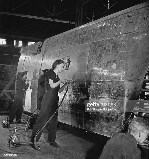 Riveters attaching the skin to the outer portion of the wing of an Avro Lancaster heavy bomber, at an Avro factory in Greater Manchester, 16th March...
