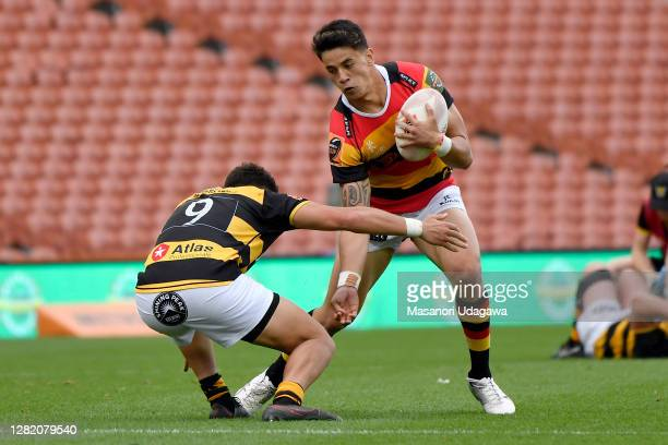Rivez Reihana of Waikato is tackled by Lisati MiloHarris of Taranaki during the round 7 Mitre 10 Cup match between Waikato and Taranaki at FMG...