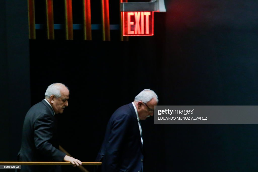 TOPSHOT - Riyad H. Mansour, (C) Palestine's Ambassador to the United Nations and Palestinian Foreign Minister Riyad al-Malki (R) exit the General Assembly hall after the vote on Jerusalem, on December 21, 2017, at UN Headquarters in New York. UN member-states were poised to vote on a motion rejecting US recognition of Jerusalem as Israel's capital, after President Donald Trump threatened to cut funding to countries that back the measure. /
