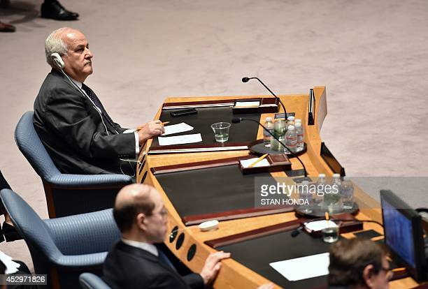 Riyad H Mansour Palestine's Ambassador to the United Nations listens to a video briefing by Valerie Amos UN UnderSecretaryGeneral for Humanitarian...