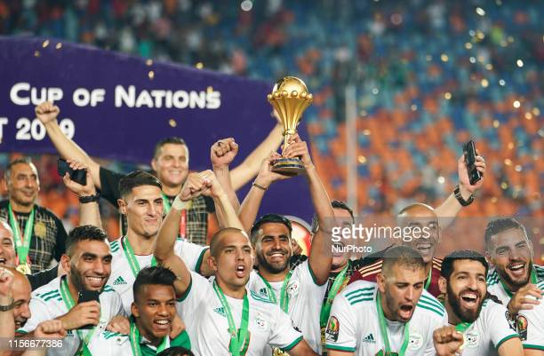 Riyad Karim Mahrez of Algeria with the trophy after the Final of 2019 African Cup of Nations match between Algeria and Senegal at the Cairo...