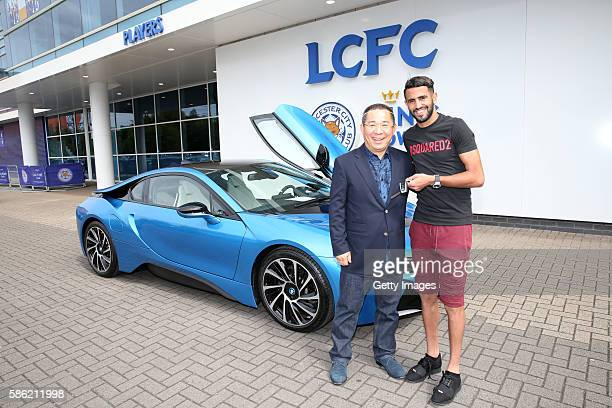 Riyad Mahrez accepts the gifts on behalf of the team from chairman Vichai Srivaddhanaprabha a fleet of 19 protonic blue BMW I8s were parked outside...