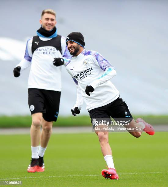 Riyad Mahrez and Aymeric Laporte of Manchester City in action during a training session at Manchester City Football Academy on January 24 2020 in...